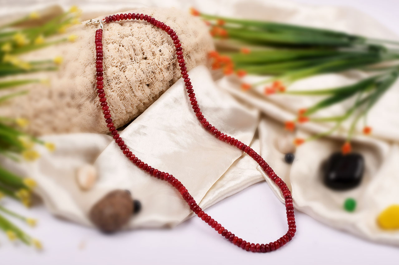 Ruby faceted Mala - Elliptical beads