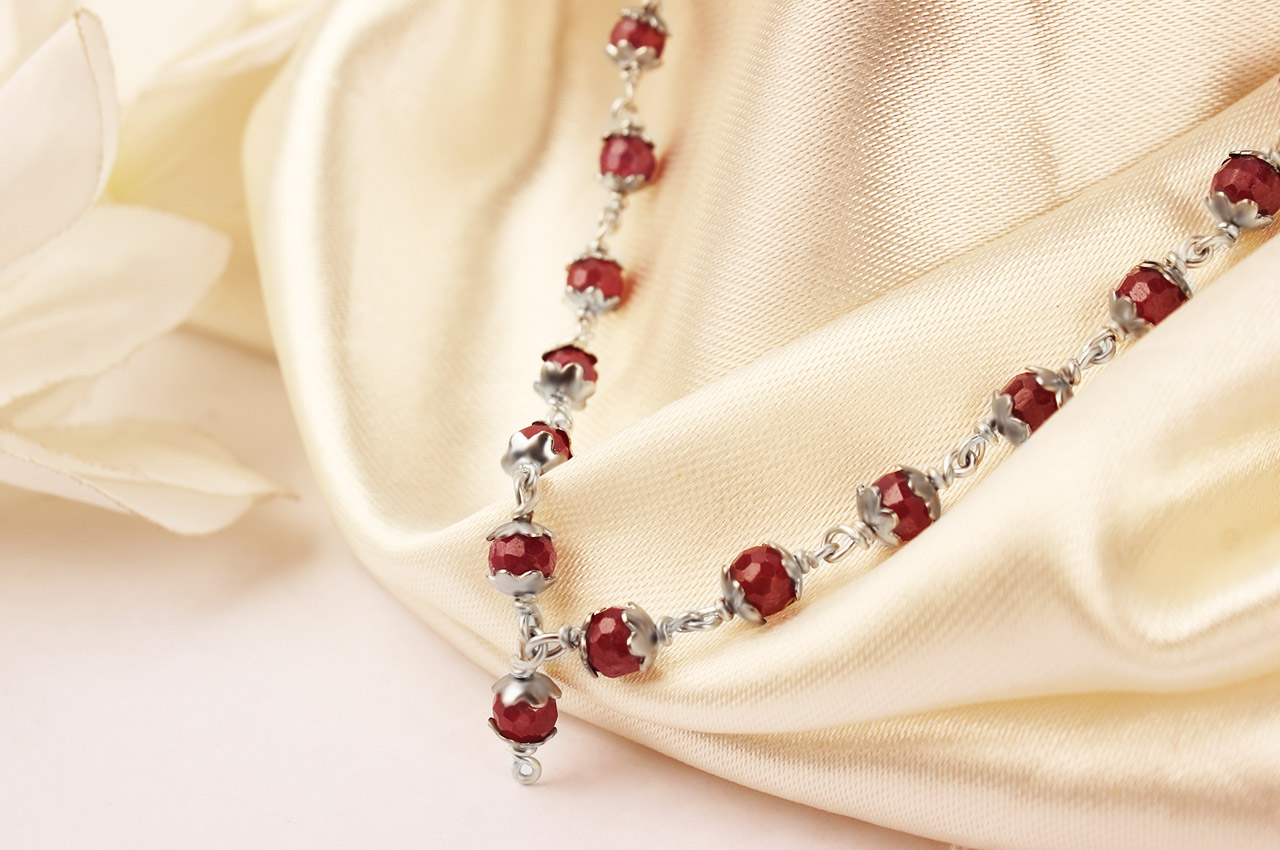 Ruby faceted Mala in pure silver flower caps - 5mm