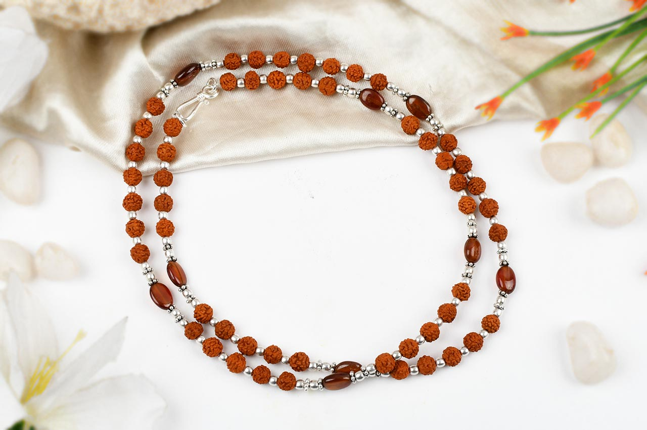 Rudraksha and Hessonite Gomed mala with silver spacers and balls