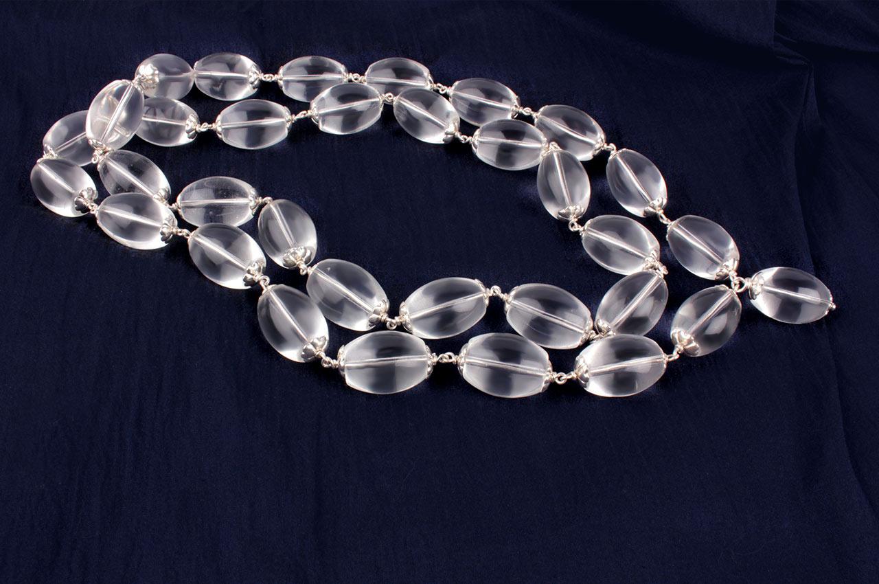 Sphatik Kantha lingam beads in Silver caps
