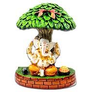 Lord Ganesha under tree