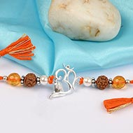 Om Rakhi With Citrine and Pearl beads