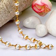 Pearl mala in pure gold caps
