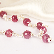 Ruby Faceted Mala in Pure Silver Flower Caps ..