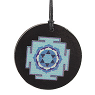 Saraswati Yantra locket on Rosewood