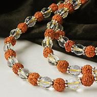 Sphatik diamond cut and Rudraksha mala in thread with silver flowers