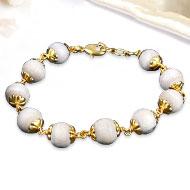 Tulsi Bracelet in gold polish copper caps