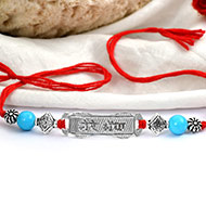 Turquoise beads Rakhi with pure silver accessories in thread